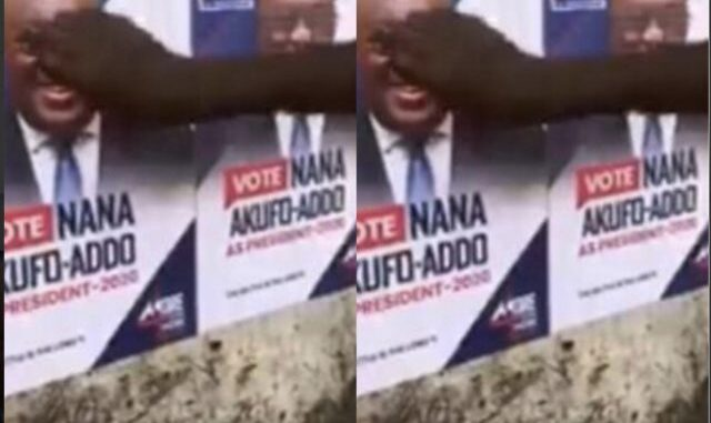 Man Filmed Knocking Akufo Addo's Head on a Poster For Lying to Ghanaians; Video Goes Viral -[WATCH VIDEO]